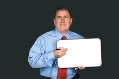 De spatie van de zakenmanholding whiteboard stock foto's