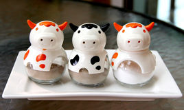 De specerij in koeien vormt flessen royalty-vrije stock afbeeldingen