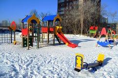 De Speelplaats van kinderen met dia's Stock Fotografie
