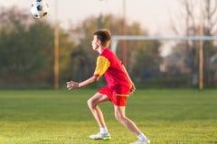 De speelvoetbal van het kind stock afbeelding