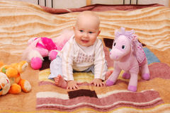 De spelen van de baby met speelgoed 4 Stock Foto