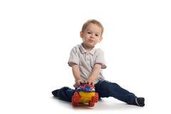 De spelen van het kind met auto Royalty-vrije Stock Foto