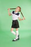 De spelen van het schoolmeisje met gevlecht haar Royalty-vrije Stock Afbeelding