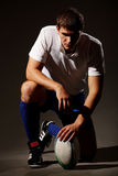 De speler in de voetbal van het Rugby Stock Foto