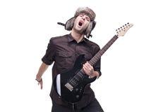 De speler die van de gitaar in midair springt stock foto