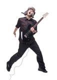 De speler die van de gitaar in midair springt stock fotografie