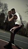 De speler die van het basketbal bal bewaakt Royalty-vrije Stock Afbeelding