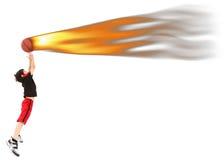De Speler die van het Basketbal van het Kind van de jongen de Bal van de Brand vangt Stock Foto's