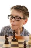 De speler die van het schaak beweging analyseert Stock Fotografie