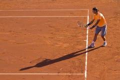 De speler en de schaduw van het tennis Royalty-vrije Stock Afbeelding