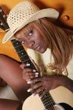 De speler van de gitaar stock fotografie