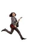 De speler van de gitaar in pak Stock Foto