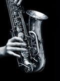 De speler van de saxofoon Stock Foto's