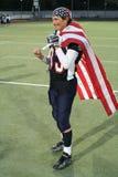 De Speler van de V.S. van het team met de Vlag van de V.S. en de Gouden Medaille Royalty-vrije Stock Afbeeldingen