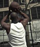 De speler van het basketbal het gaan voor wint Stock Foto