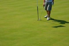 De speler van het golf op groen Stock Foto
