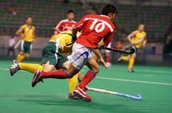 De Speler van het hockey in Actie Stock Foto