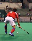 De Speler van het hockey in Actie Stock Afbeelding
