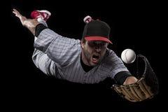 De Speler van het honkbal op een rood uniform. Royalty-vrije Stock Fotografie