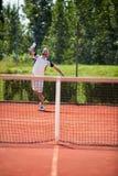 De speler van het tennis met racket stock foto