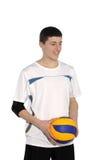 De speler van het volleyball met de bal Stock Afbeeldingen