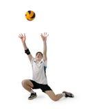 De speler van het volleyball met de bal op een wit Stock Fotografie