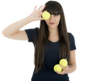 De speler van het vrouwentennis een racket en ballen houden die, die op een wh wordt geïsoleerd Stock Foto