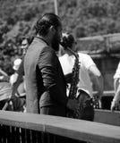 De speler van de straatsaxofoon stock fotografie
