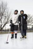 De spelerjongens van het ijshockey. royalty-vrije stock afbeelding