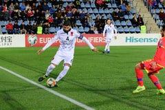 De spelers in actie bij Europese Kampioenschaps Kwalificerende gelijke passen tussen Andorra versus Albanië, definitieve score EN royalty-vrije stock afbeeldingen