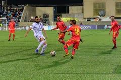 De spelers in actie bij Europese Kampioenschaps Kwalificerende gelijke passen tussen Andorra versus Albanië, definitieve score EN royalty-vrije stock foto