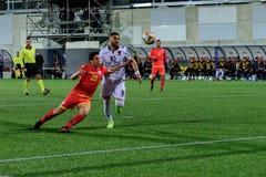 De spelers in actie bij Europese Kampioenschaps Kwalificerende gelijke passen tussen Andorra versus Albanië, definitieve score EN royalty-vrije stock foto's