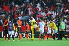 De spelers die van Sevilla FC de overwinning vieren stock foto