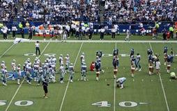 De Spelers en Cheerleaders van cowboys Stock Afbeelding
