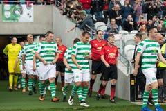 De spelers gaan de hoogte van Pairc Ui Chaoimh voor de Liam Miller Tribute-gelijke in stock foto