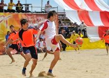 De spelers van Beachfootball stock afbeeldingen