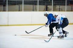 De spelers van de ijshockeysport stock afbeeldingen