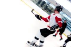 De Spelers van het hockey breken snel Stock Foto