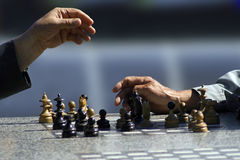 De spelers van het schaak Stock Foto's