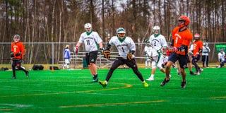 De spelers van de lacrossesport op het gebied royalty-vrije stock foto