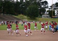 De spelers van Stanfords vloeien het gebied weg stock fotografie
