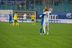 De spelers vieren de overwinning stock afbeelding