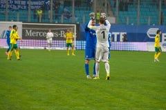De spelers vieren de overwinning stock foto's