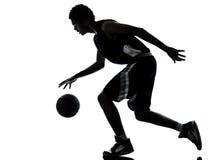 De spelersilhouet van het basketbal Stock Foto's