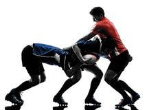 De spelerssilhouet van rugbymensen Stock Foto