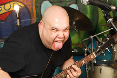 De speleruitdrukking van de gitaar Stock Fotografie