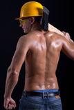 De spierhouthakkersbijl van de mensenholding op zwarte achtergrond Royalty-vrije Stock Foto