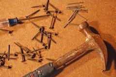 De Spijkers en de Schroeven van de hamer Stock Fotografie