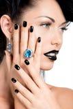 De spijkers van de glamourvrouw, lippen en ogen geschilderde kleurenzwarte Royalty-vrije Stock Afbeeldingen