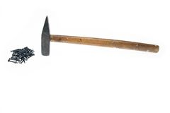 De spijkers van de hamer op witte achtergrond Royalty-vrije Stock Foto